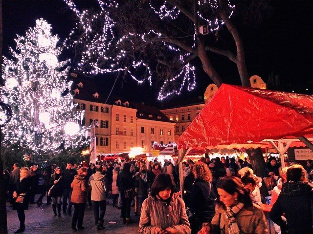 People enjoying the hot wine at the Christmas Market on the Main square in old town of Bratislava.