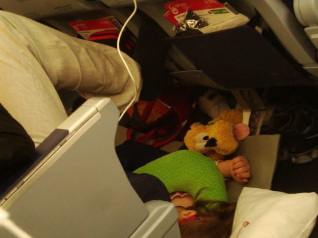 kid on plane under the seat
